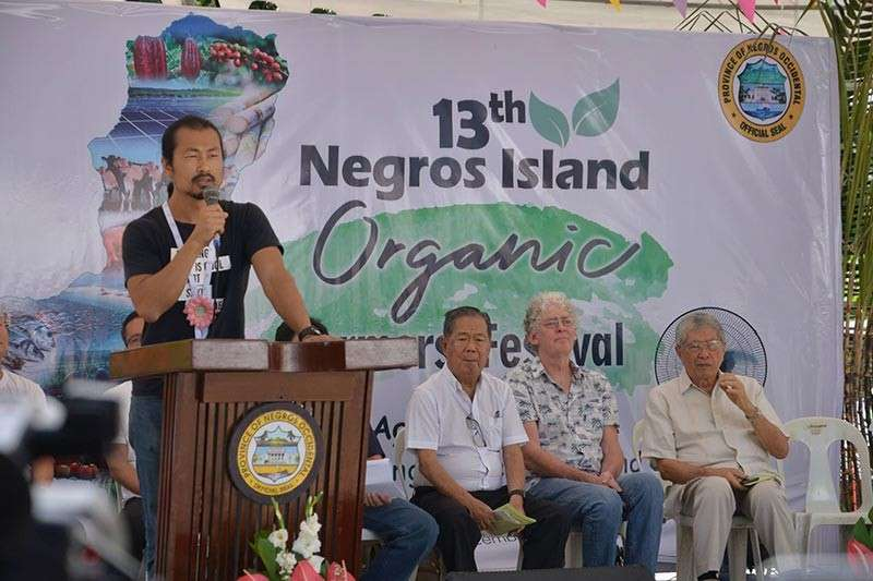 Sam Society of Organic Movement Chief Executive Officer Rei Yoon speaks at the opening rites of the 13th Negros Island Organic Farmers Festival at the Capitol grounds in Bacolod City yesterday. (Richard Malihan)