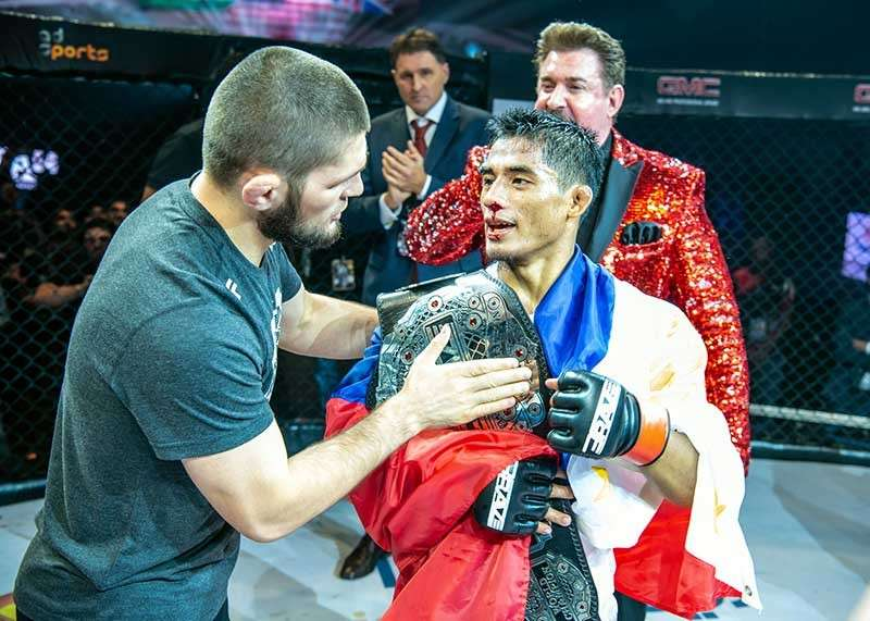BAGUIO. Team Lakay's Stephen Loman is congratulated by UFC lightweight world champion Khabib Nurmagomedov after retaining his bantamweight title in his second defense last month in Bahrain. (Photo courtesy of Brave Combat Federation)