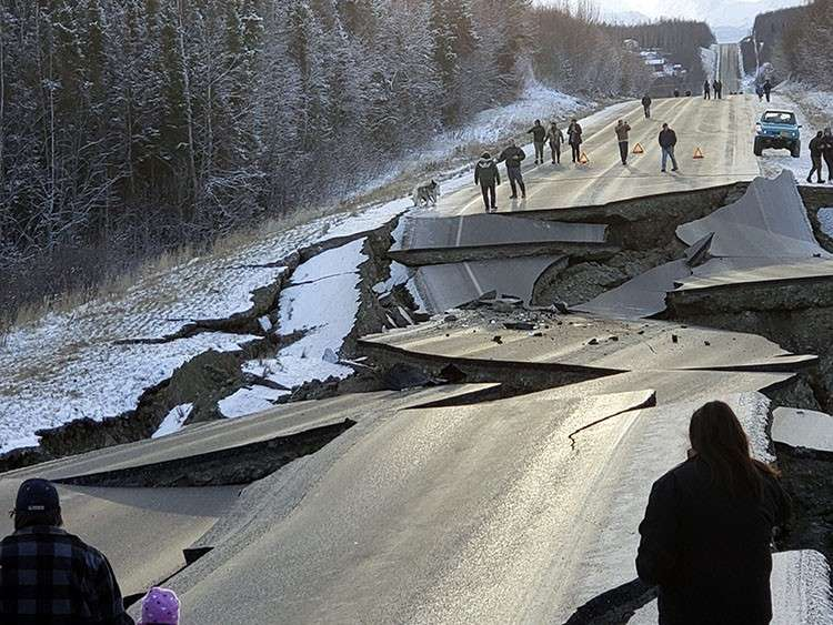 ALASKA. In this photo provided by Jonathan M. Lettow, people walk along Vine Road after an earthquake, Friday, November 30, 2018, in Wasilla, Alaska. (AP)