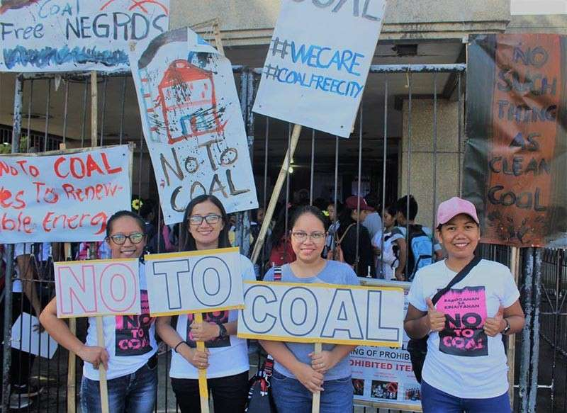 """BACOLOD. Some of the youth-participants of the caravan with """"No to Coal"""" placards, signifying their support to the church's call for a clean environment in San Carlos City on Friday, November 30. (Social Action Center–San Carlos)"""