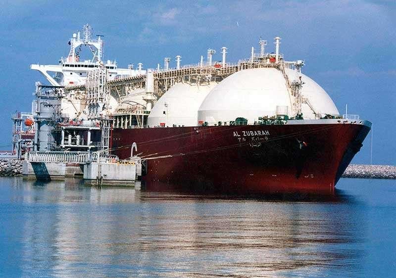QATAR. This undated file photo shows a Qatari liquid natural gas (LNG) tanker ship being loaded up with LNG at Raslaffans Sea Port, northern Qatar. (AP File)