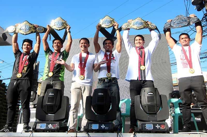"BAGUIO. Team Lakay proudly raise their belts this year during the ""Heroes Parade"" spearheaded by the City Government of Baguio. (Photo by Jean Nicole Cortes)"