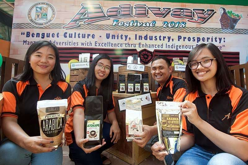 BAGUIO. Locally-grown Benguet coffee is showcased at the Adivay Festival trade fair. Benguet- grown Arabica coffee recently won three spots in the top six of the 2018 Philippine Coffee Quality Competition. (Photo by Jean Nicole Cortes)