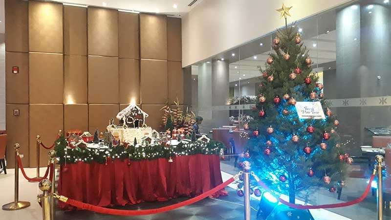 CAGAYAN DE ORO CITY. Limketkai Luxe Hotel's gingerbread house and Christmas tree which is made from fresh pine tree flown from the United States. (Jo Ann Sablad)