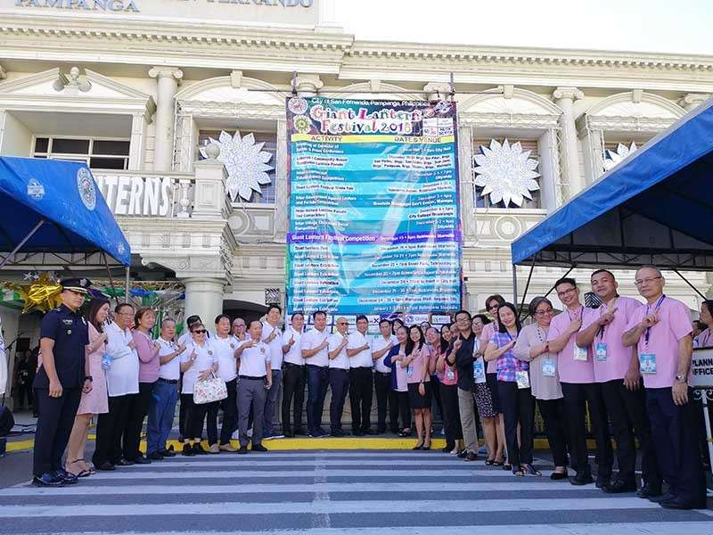 PAMPANGA. Mayor Edwin Santiago, Vice-Mayor Jimmy Lazatin, Councilor Harvey Quiwa, Giant Lantern Festival Executive Committee members led by Chairman Alex Patio and other city officials led the unveiling of the Giant Lantern Festival calendar of activities on Monday at city hall. (Nicole Renee David)