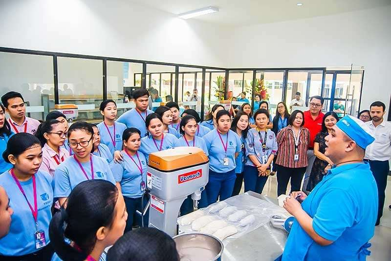 OPPORTUNITIES. Pilmico bakery technician chef Wilburt Wong teaching students of Tesda Women's Center  how to make fresh pan de sal at the Wooden Spoon business innovation center. (Contributed photo)