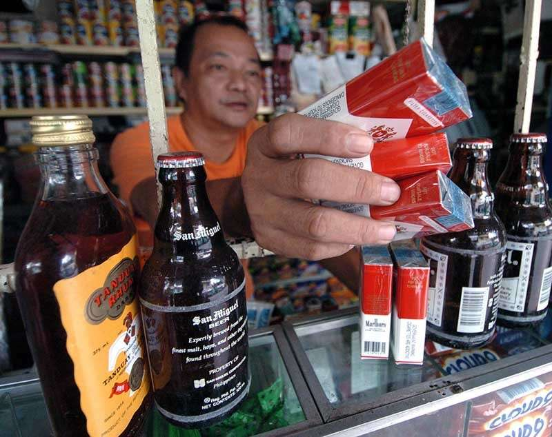 APPROVED. Consumers have to pay more when the House of Representatives approves tax hikes on tobacco and alcohol. (SunStar file photo)