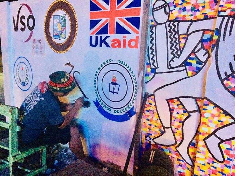 Artist Artche Patrombon doing the logos for the Peace Painting. (Contributed photo)
