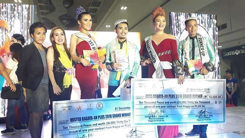 CAGAYAN DE ORO. Reynan Panoy Baguio (center left) and Gemini Elorde Matulac (center right) were crowned as the Mister and Miss Kagay-an PLUS 2018. (Jo Ann Sablad)