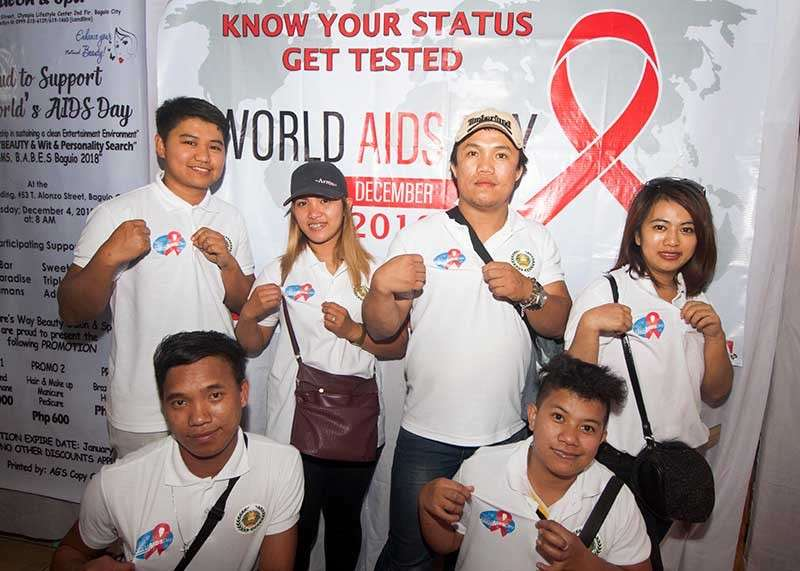 BAGUIO. HIV-Aids advocates show their shirts with the symbolic ribbon to advocate awareness of the disease. More than 9.4 million people do not know that they are living with Aids. (Photo by Jean Nicole Cortes)