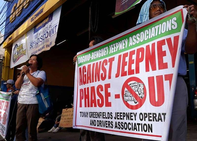 BAGUIO. A drivers' association holds a rally opposing the proposed phase out of jeepney saying the plan is a scheme to monopolize public transport. (Joven Peralta)