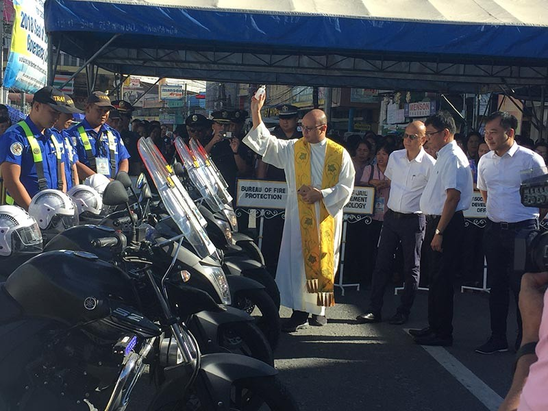 CITY OF SAN FERNANDO. Reverend Fr. Ervin Ray Garcia blesses the new motorcycle units of the City Traffic Management Division. Accompanying him are Mayor Edwin Santiago, Vic-Mayor Jimmy Lazatin, and Councilor Harvey Quiwa. (Princess Clea Arcellaz)