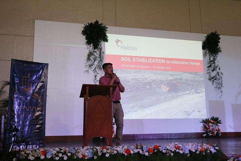 Holcim Philippines head of Infrastructure John Edward Reyes discusses how soil stabilization technology can help in building more durable roads within deadline and budget in the 4th Research Symposium on Rapid Construction Methods by the Department of Public Works and Highways. The forum was held at the Bahay ng Alumni in UP Diliman on October 18. (Contributed photo)