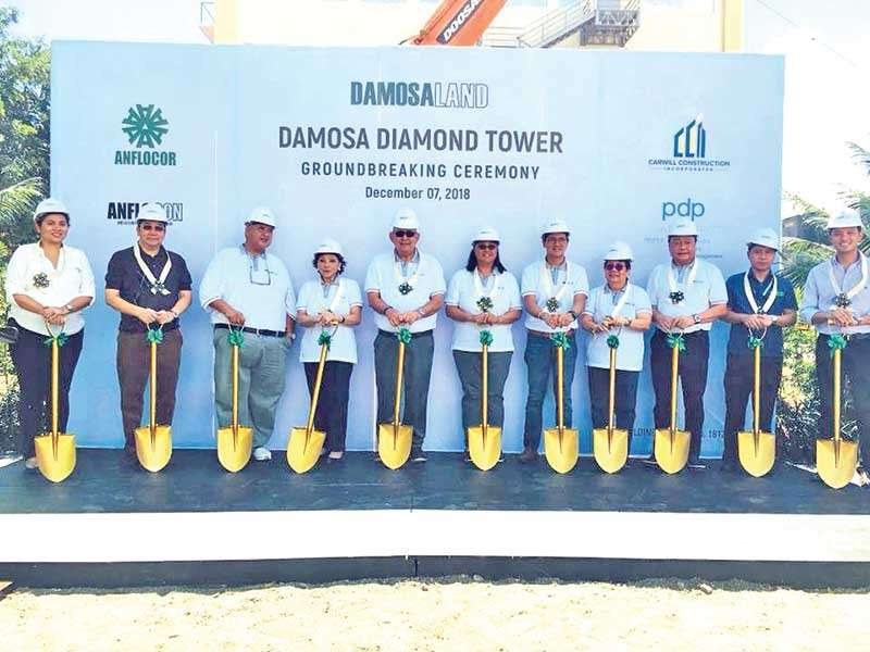 DAVAO. Damosa Land Inc. officials led by its vice president Ricardo Lagdameo breaks ground on Friday its newest project - the Diamond Tower. It is a 15-storey building for commercial spaces which is set to be completed by 2020. (Contributed photo)
