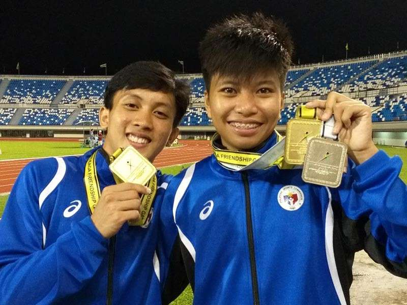 BACK-TO-BACK. Jhon Lloyd Cabalo and Jessel Lumapas pose with their men's and women's 400-meter gold medals Friday evening in the first day of BIMPNT-Eaga Friendship Games 2018 athletics competition at the Hassanal Bolkiah National Sports Complex in Bandar Seri Begawan, Brunei. (Marianne L. Saberon-Abalayan)