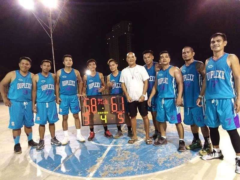 Ballpals 39-below champion Team Sumanga strikes a pose with tournament director Andit Mendoza after their thrilling victory over Team Galanida at the Palaro court. (Contributed Photo)