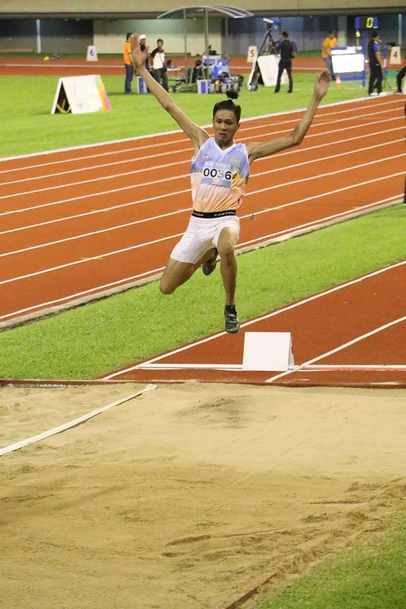 FINAL JUMP. Davao City's Mark Anthony Caseñas leaps to a golden finish in his final attempt in men's long jump of the 10th BIMPNT-Eaga Friendship Games at the Hassanal Bolkiah National Sports Complex in Brunei late Saturday evening. Story on Page 19. (PSC photo)