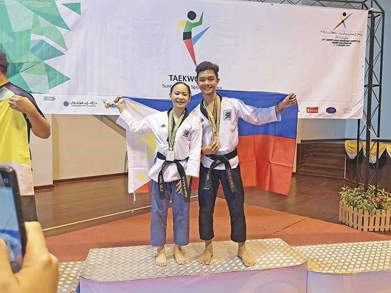 DAVAO. Jins Elah Janica Liwag and Juan Miguel Dalangin win the poomsae mixed pair gold medal for Team Mindanao-Philippines at the close of the 10th BIMPNT-Eaga Friendship Games taekwondo competition in Brunei Sunday, December 9, 2018. (Janica Liwag Facebook)