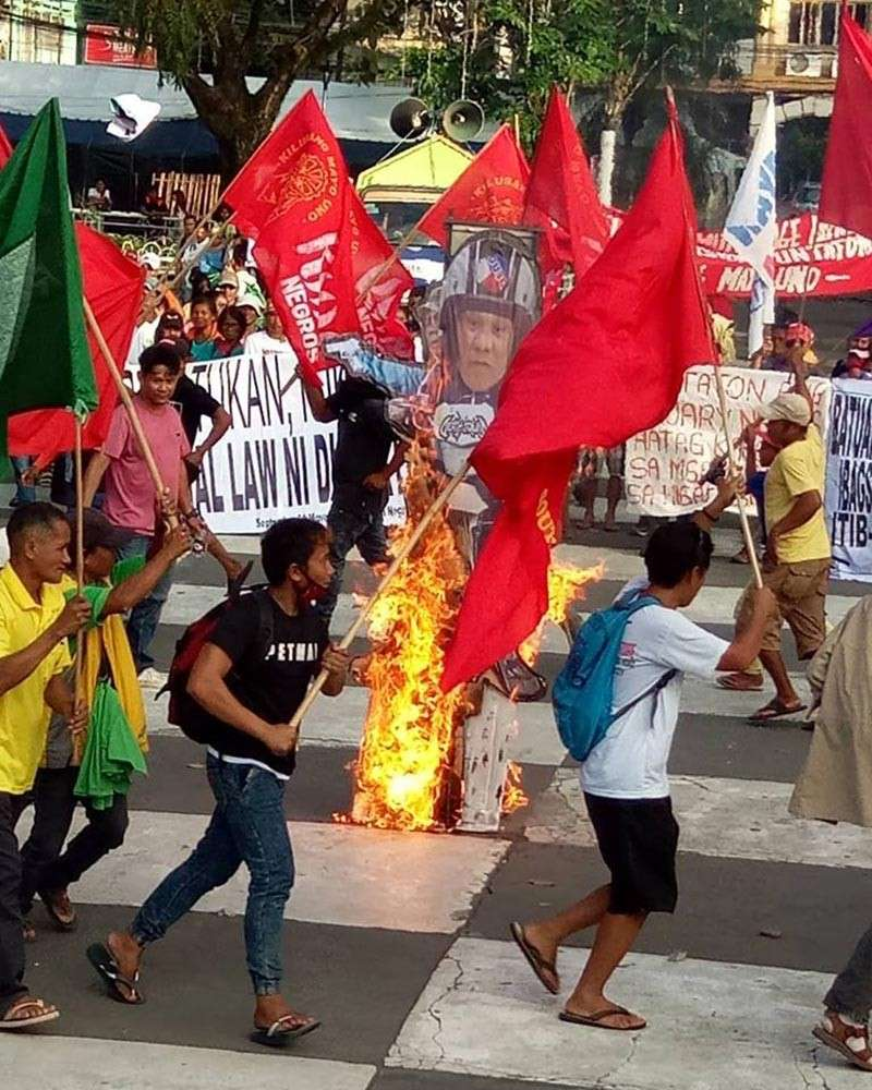 BACOLOD. Some members of progressive groups in Negros Occidental burn the effigy of President Rodrigo Duterte during the commemoration of the International Human Rights Day in Bacolod City public plaza on Monday, December 10. (Nonoy Espina)