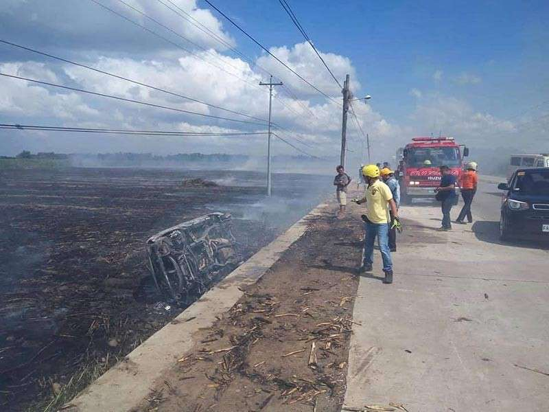 HIMAMAYLAN. Rescuers arrived at the area where a sports utility vehicle fell on a burning sugarcane field in Barangay To-oy, Himamaylan City, Negros Occidental on Monday, December 10. (Kabankalan CDRRMO)