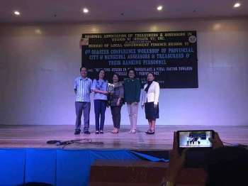 ILOILO. Acting Provincial Treasurer Jean Maire Umadhay (2nd from left) receiving the plaque of appreciation. With her is Provincial Assessor's Office led by May Katherine Sullano (2nd from right). (Contributed photo)