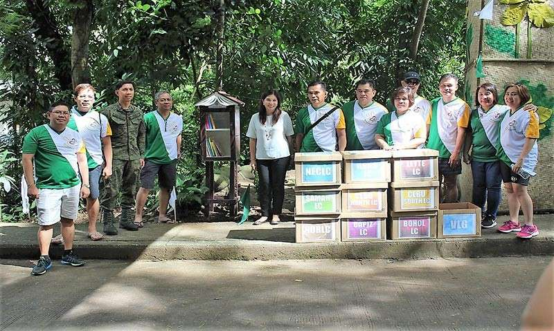 MURCIA. Employees of the Land Bank of the Philippines donated pocket libraries during the launching of the Learning Conservation Program led by Mambukal Mountain Resort manager Ellen Marie Jalandoni (5th from right) and Colonel Benedict Arevalo (3rd from left), commander of the 303rd Infantry Brigade of the Philippine Army, on December 8. (Contributed photo)