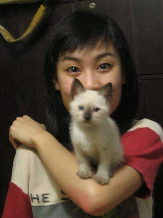 My sister Jennie with Mingu as a kitten (James Edgar Sia)