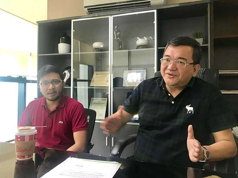 FATHER AND SON. AppleOne Properties president and chief executive officer Ray Go Manigsaca (right) bares the company's plans for 2019. His son Ray Patrick, assistant vice president for business development, also shares his insights on mixed-use developments. (SunStar photo/Katlene O. Cacho)