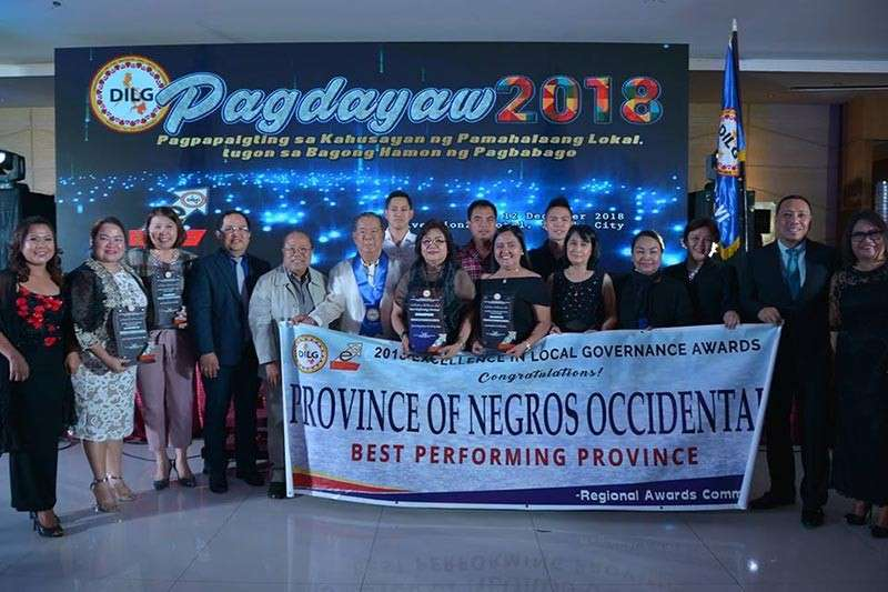 """ILOILO. Provincial government officials led by Governor Alfredo Marañon Jr. receive the """"Best Performing Province"""" award for Negros Occidental and other special awards during the Excell Awards 2018 in Iloilo City on Wednesday, December 12. (Contributed photo)"""