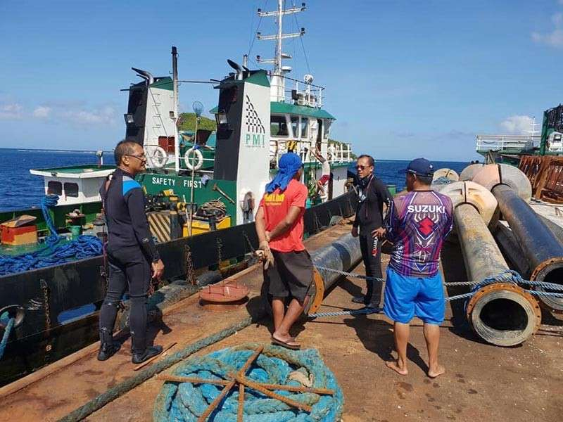 Sipalay City Councilor Dionilo Bogtae and the personnel of Philippine Coast Guard respond to the sunken barge, wherein 11 crew members were rescued in Barangay Cartagena, Sipalay City, Negros Occidental on Wednesday, December 12. (Contributed photo)