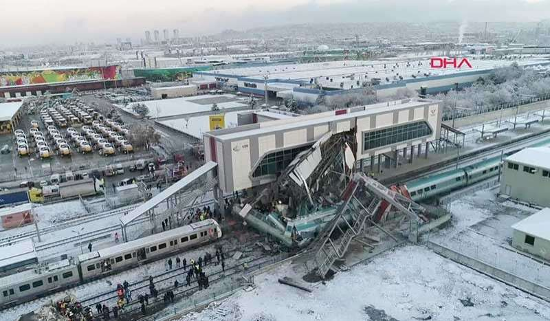 TURKEY. This image made from video shows aftermath of a high-speed train crash at a station in Ankara, Turkey, Thursday, Dec. 13, 2018. The train hit a railway engine and crashed into a pedestrian overpass at the station on Thursday. (DHA via AP)