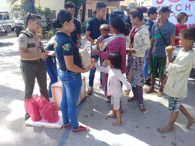 BACOLOD. Personnel of the Bacolod City Police Office, along with the City Social Services Department, conduct a dialogue and feeding program to some Badjaos who were rescued this week. (Contributed photo)