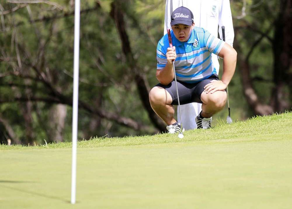 BAGUIO. Benguet golfing pride Luigi Paolo Wong aligns his putt at Camp John Hay with his team Royal Northwoods trailing by 42 points going into the penultimate day of the 69th Fil-Am Invitational at the Camp John Hay golf course. (Fil-Am Media photo)