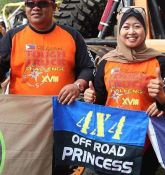 CAGAYAN DE ORO. Nama Juraidah bt Jantan with her husband Mohd Rahim Bin Sarkam during the 13th and last leg of the Philippine Tough Truck Challenge XVII at the Libona Central School grounds, Bukidnon. (Leonides S. Biantan)