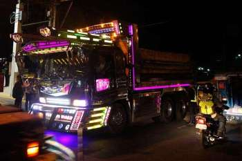 """BAGUIO. A colorful 10-wheeler truck traverses the busy streets of La Trinidad at night. The Land Transportation Office reiterated its previous memo on LED lights and other fixtures adding """"use of LED or HID (high-intensity discharge) lamps is allowed as long as it adheres to the parameters."""" (Photo by Jean Nicole Cortes)"""