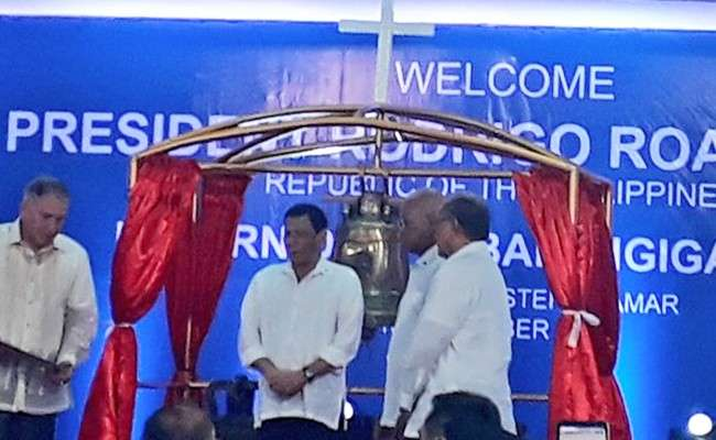 EASTERN SAMAR. President Rodrigo Duterte on Saturday, December 15, led the ceremonial turnover of three historic bells here at the Balangiga auditorium, which is in in front of the San Lorenzeno de Martir church where the bells originally belonged. (Ruth Abbey Gita)