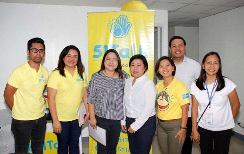 PAMPANGA. Angeles University Foundation Director of Student Affairs Gwendelyn Oronce (3rd, L) and China Online Innovations, Inc. Vice President Jennifer Que (4th, L) are joined by center representatives during the launch of 51Talk Angeles recently. (Contributed Photo)