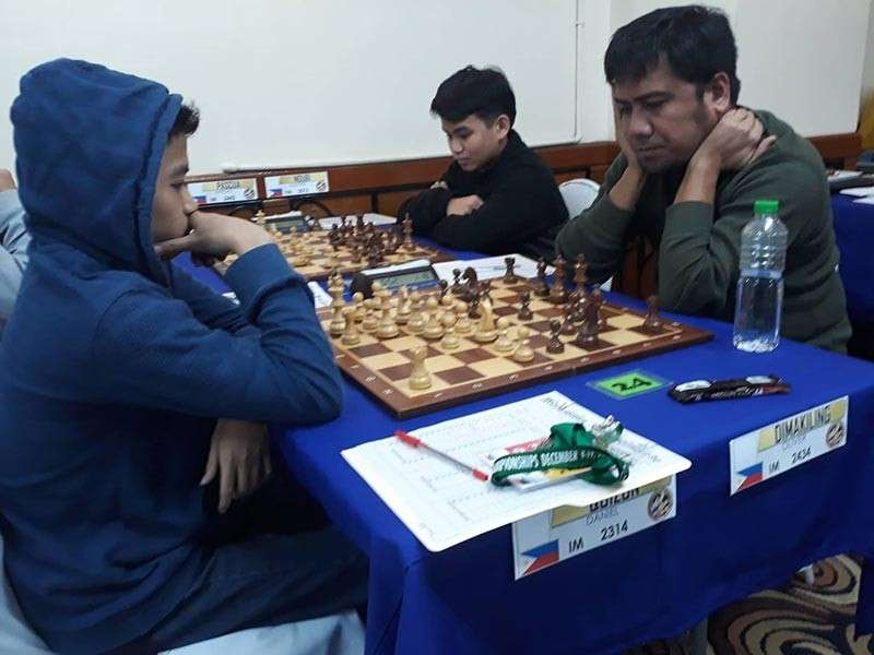 MAKATI CITY. Davao City's international master (IM) Oliver Dimakiling, right, studies his next move against fellow Filipino IM Daniel Quizon in their fifth round encounter of the ongoing 17th Asian Continental Chess Championships 2nd Manny Pacquiao Cup at Tiara Oriental Hotel in Makati City Friday, December 14. The Dabawenyo loses this one. (Courtesy of James Infiesto)