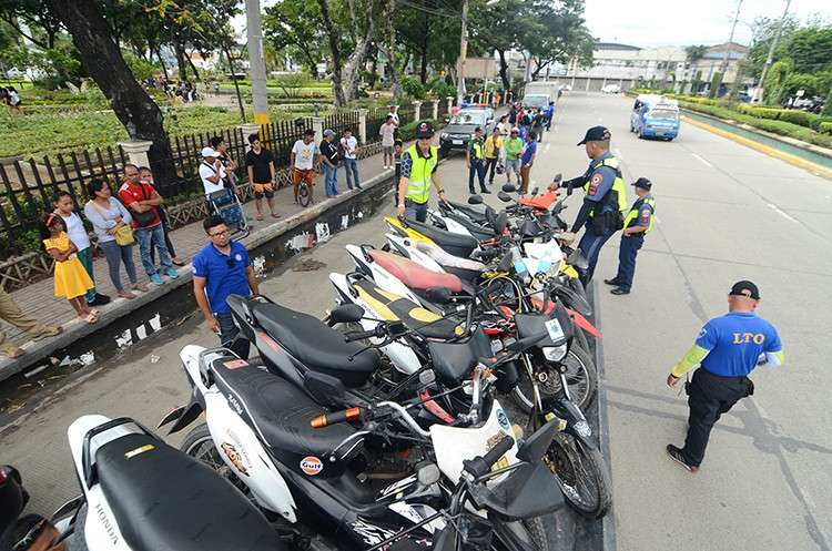Crackdown. Several motorcycles were impounded in front of the Plaza Independencia on Saturday, Dec. 15, when the Land Transportation Office 7 and the Highway Patrol Group 7 implemented Republic Act 4136, which prohibits motorcycles from being used as public transport. (SunStar Foto / Alan Tangcawan)