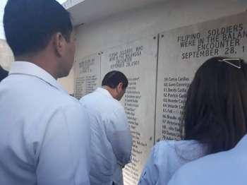 EASTERN SAMAR. After the ceremonial turnover of the Balangiga bells, President Rodrigo Duterte prays for the Filipino soldiers who were in the 1901 Balangiga encounter. (Ruth Abbey Gita)