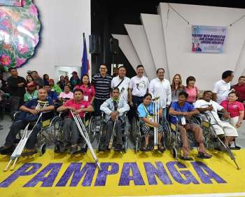 PAMPANGA. Vice Governor Dennis Pineda, board members Rosve Henson, Fritzie David-Dizon and Anthony Joseph Torres, and Provincial Disaster Risk Reduction and Management Officer Angie Blanco join PWDs during the general assembly at the Bren Z. Guiao Convention Center in the City of San Fernando. (Contributed photo)