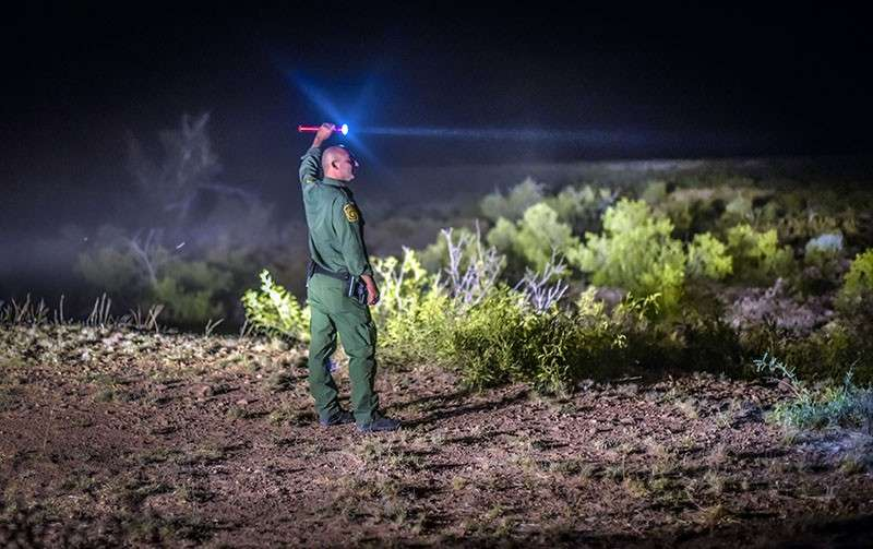 In this June 24, 2015, file photo, a Border Patrol agent looks for other agents in the Animas mountains in New Mexico's boot heel. A seven-year-old Guatemalan girl, picked up with her father and dozens of other migrants along the remote stretch of the U.S.-Mexico border, has died, federal officials said Friday, December 14, 2018. (AP photo)