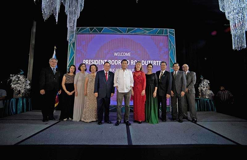 Philippine President Rodrigo R. Duterte with Halifax Davao Hotel Inc. president Francis Ledesma, Rosie Dominguez, Emmy Huang, Cynthia Dominguez, founding chairman Department of Finance Secretary Carlos Dominguez, Wharf Hotels Management president Dr. Jennifer Cronin, Marco Polo Davao general manager Dottie Wurgler-Cronin, Halifax Davao Hotel Inc. chairman Bienvenido Tan, Adrian Juanengo, Rafael Dominguez (Contributed photo)