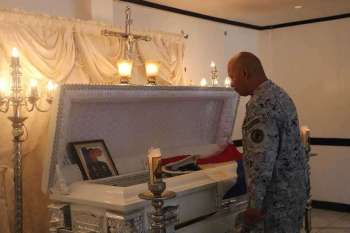 ZAMBOANGA. Rear Admiral Rene Medina, Naval Forces Western Mindanao (NFWM) command chief, pays his last respects to Marine Sergeant Randy Cariaso, who was killed fighting the Abu Sayyaf bandits on December 13 on Minis Island, Patikul, Sulu. (Contributed photo)