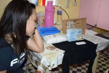 """ZAMBOANGA. A police photo handout shows Marrisa Wee, 32, who was arrested in a drug bust on Sunday, December 16 that led to the confiscation of a kilo of suspected """"shabu"""" worth P6.8 million in the village of Upper Calarian, Zamboanga City. (Contributed photo)"""