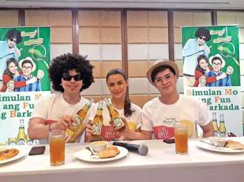 DAVAO. San Miguel flavored beer endorser Yassi Pressman and her gang Fro Bro and Geek Guy toast with SanMig flavored beers for a photo op after the press conference on Sunday, December 22 at Jade Room, Marco Polo Davao. (Contributed photo)