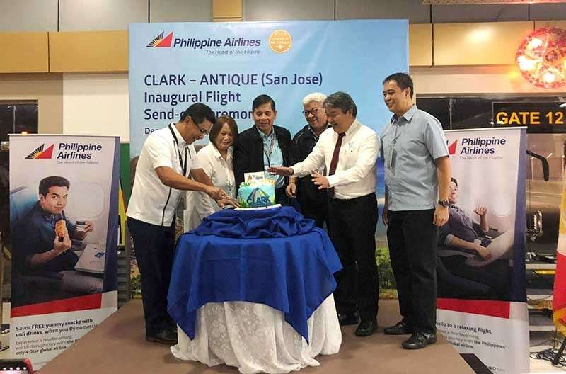 PAMPANGA. Clark International Airport Corporation (CIAC) OIC/acting president and CEO Jaime Alberto Melo (left) slices the cake during the inauguration of the Philippine Airlines (PAL) flight service between Antique (IATA:EUQ) and the Clark International Airport (IATA:CRK). With Melo are: (L-R) PAL Area Manager for Metro Manila and Luzon Ma. Divinagracia Virata; Department of Transportation (DOTr) Undersecretary for Aviation and Airports Capt. Manuel Antonio Tamayo; Civil Aviation Authority of the Philippines (CAAP) director general Capt. Jim Sydiongco; PAL Express Clark branch manager Christopher Lebumfacil; and, CIAC vice president for Airport Operations and Management ret. Gen. Raul Del Rosario. The service arrives in Clark at 9 a.m. and leaves at 6 a.m. every Sunday and Tuesday. (Photo courtesy of Lyn Sanchez, CIAC - Marketing Department)