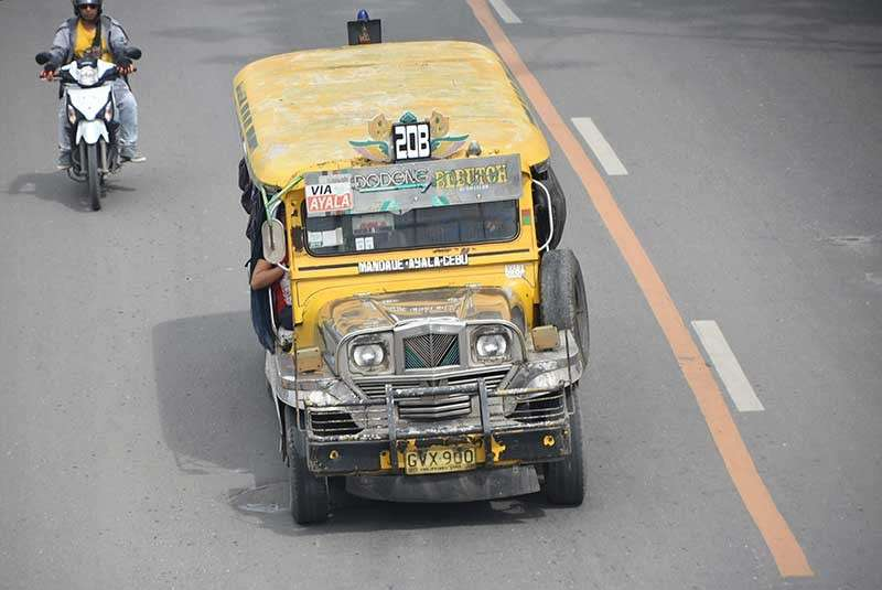 SIDE-BY-SIDE. The longest-running jeepney design has the passengers huddled into two rows. (SunStar photo/Allan Cuizon)