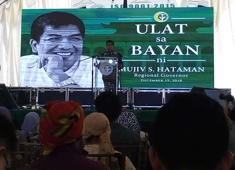 """ZAMBOANGA. Governor Mujiv Hataman of the Autonomous Region in Muslim Mindanao on Wednesday, December 19, urges the ARMM residents to actively participate in the plebiscite for the ratification of the Bangsamoro Organic Law next year as he delivers his last """"Ulat sa Bayan"""" in Cotabato City. (Bong Garcia)"""