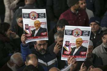 ISTANBUL. In this November 16, 2018 file photo, members of Arab-Turkish Media Association and friends of Washington Post columnist Jamal Khashoggi hold posters showing images of Saudi Crown Prince Muhammed bin Salman and of Khashoggi, as they attend funeral prayers in absentia for him following his killing the previous month in the Saudi Arabia consulate, in Istanbul. (AP)